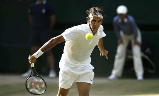 Roger Federer of Switzerland watches a return over the net to Milos Raonic of Canada during their men's singles semifinal match at the All England Lawn Tennis Championships in Wimbledon, London, Friday, July 4, 2014. (AP Photo/Ben Curtis)