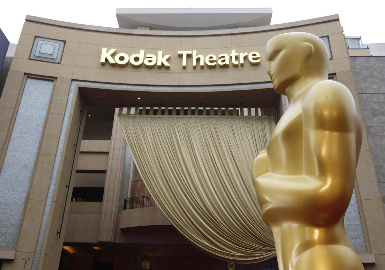 FILE - In this Feb. 26, 2012 file photo, an Oscar state is displayed outside the Kodak Theatre in preparation for the 84th Academy Awards in Los Angeles. The Academy Awards' home at Hollywood's former Kodak Theatre is being renamed the Dolby Theatre. Facility owner CIM Group on Tuesday announced a 20-year naming deal with the audio technology company Dolby Laboratories Inc. (AP Photo/Amy Sancetta, file)