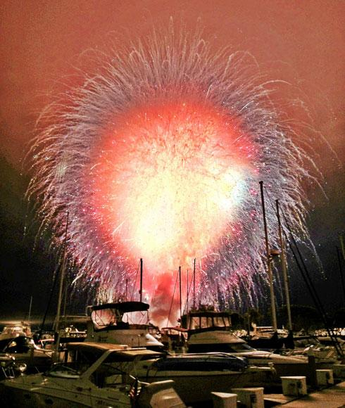 All 20,000 fireworks lit the sky in 15 seconds when they were accidentally set off prematurely by a computer glitch at the San Diego Independence Day show, in San Diego July 4, 2012.  The explosives were launched from four barges in San Diego Bay and from a pier. The fireworks, all 20,000 of them, went off five minutes before the show was supposed to begin and thousands of disappointed spectators were told the display was over. REUTERS/Ben Baller/ifandco.com/Handout