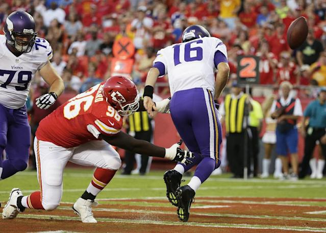 Kansas City Chiefs defensive tackle Jaye Howard (96) forces a safety against Minnesota Vikings quarterback Matt Cassel (16) during the first half of an NFL preseason football game in Kansas City, Mo., Saturday, Aug. 23, 2014. (AP Photo/Charlie Riedel)