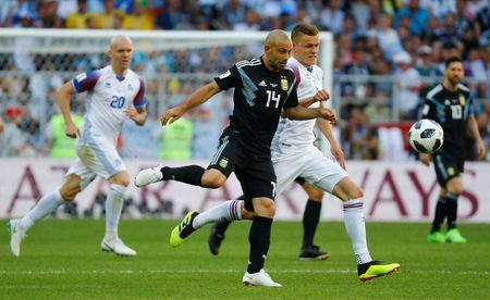 Soccer Football - World Cup - Group D - Argentina vs Iceland - Spartak Stadium, Moscow, Russia - June 16, 2018 Argentina's Javier Mascherano in action with Iceland's Alfred Finnbogason REUTERS/Kai Pfaffenbach