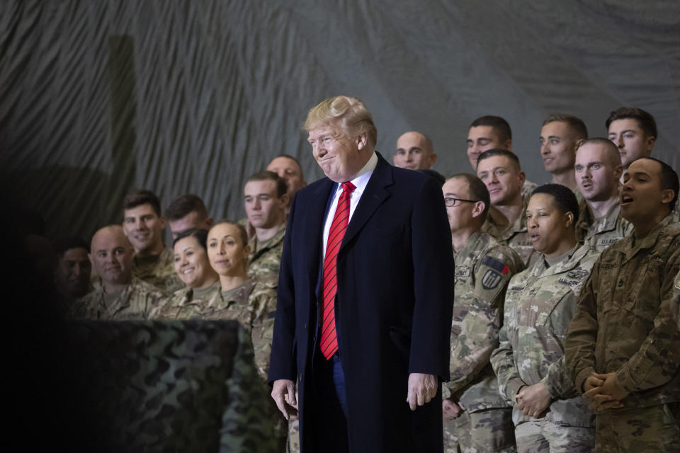 FILE - In this Nov. 28, 2019, file photo President Donald Trump smiles before addressing members of the military during a surprise Thanksgiving Day visit at Bagram Air Field, Afghanistan. Trump has held himself up as a champion of U.S. troops without rival. Now, with his presidency on the line, he's casting suspicion on a tool of participatory democracy, the mail-in ballot, that has allowed U.S. military personnel to participate in elections while serving far from home since the War of 1812. (AP Photo/Alex Brandon, File)