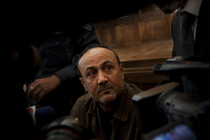 FILE - In this Jan. 25, 2012, file photo, senior Fatah leader Marwan Barghouti appears at Jerusalem's court. Palestinian President Mahmoud Abbas has announced that the first presidential and parliamentary elections since 2006 will be held later in 2021. The voting is seen as a key step in mending a rift between Abbas' Fatah party that rules the West Bank and the Islamic militant group Hamas that controls the Gaza Strip. (AP Photo/Bernat Armangue, File)