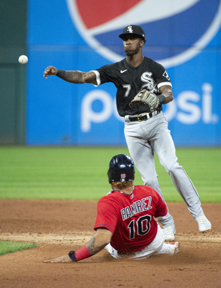 Chicago White Sox's Tim Anderson forces Cleveland Indians' Harold Ramirez at second base and completes a double play by throwing Austin Hedges out at first during the second inning of a baseball game in Cleveland, Saturday, Sept. 25, 2021. (AP Photo/Phil Long)