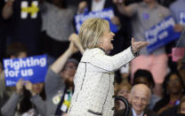 <p>Democratic U.S. presidential candidate Hillary Clinton exults at the outcome of the South Carolina race at a primary night party in Columbia, S.C., on Saturday. <i>(Photo: Randall Hill/Reuters)</i></p>