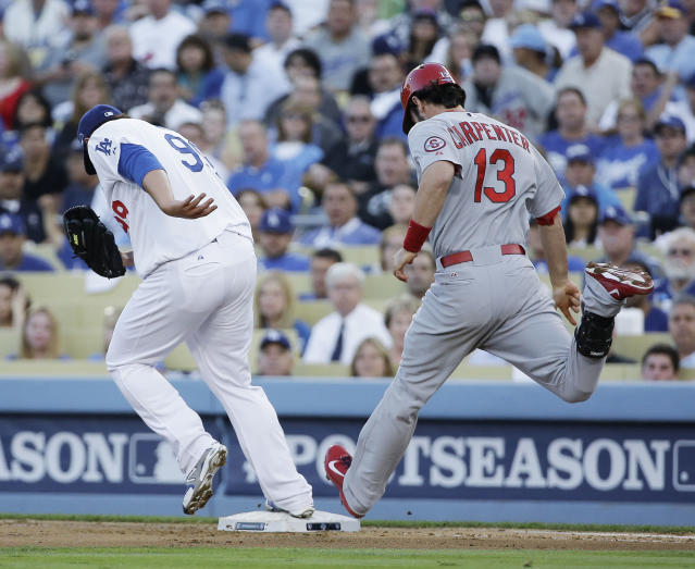 Los Angeles Dodgers starting pitcher Hyun-Jin Ryu beats St. Louis Cardinals' Matt Carpenter to first on a ground ball during the third inning of Game 3 of the National League baseball championship series, Monday, Oct. 14, 2013, in Los Angeles. (AP Photo/David J. Phillip)