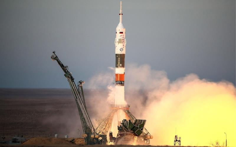 A Soyuz rocket with Russian, American and Canadian astronauts on board begins its launch on Monday - TASS / Barcroft Media