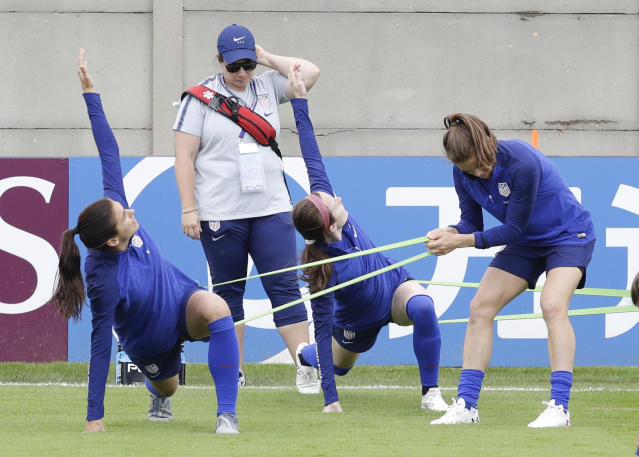 From left United States players Alex Morgan, Rose Lavelle and Kelley O'Hara warm up during a training session at the Terrain d'Honneur Lucien Choine stadium a day before the Group F soccer match between United States and Chile at the Women's World Cup in Paris, Saturday, June 15, 2019. (AP Photo/Alessandra Tarantino)