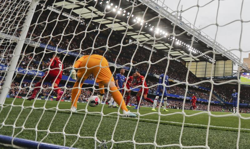 Liverpool's Roberto Firmino celebrates after scoring his side's second goal during the British Premier League soccer match between Chelsea and Liverpool, at the Stamford Bridge Stadium, London, Sunday, Sept. 22, 2019. (AP Photo/Frank Augstein)