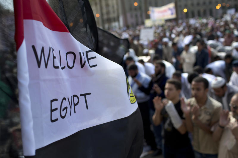 Egyptian Muslims pray during a rally in Tahrir Square in Cairo, Friday, Nov. 9, 2012. Thousands of ultraconservative Muslims rallied in the Egyptian capital, demanding the country's new constitution be based on the rulings of Islamic law, or Shariah. (AP Photo/Bernat Armangue)