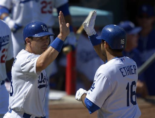 Los Angeles Dodgers' Matt Treanor, left, congratulates Andre Ethier after he hit a two-run home run during the third inning of their baseball game against the St. Louis Cardinals, Sunday, Sept. 16, 2012, in Los Angeles. (AP Photo/Mark J. Terrill)
