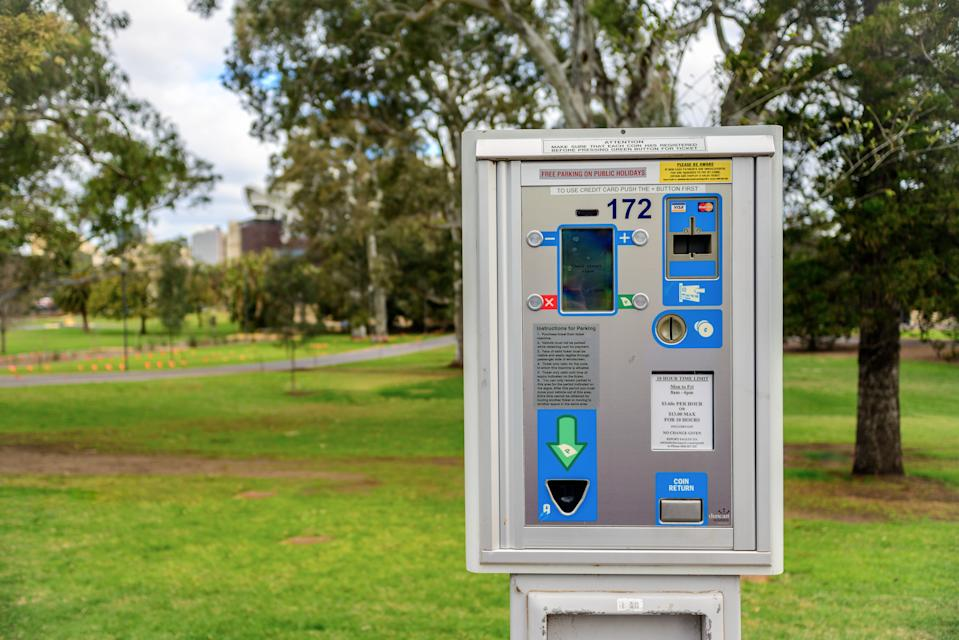 Adelaide: Parking meter  installed near St. Peter's Cathedral in Adelaide CBD with cars parked along the street
