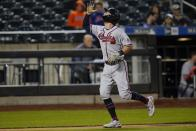 Atlanta Braves' Dansby Swanson gestures as he runs the bases after hitting a three-run home run during the third inning of a baseball game against the New York Mets Tuesday, June 22, 2021, in New York. (AP Photo/Frank Franklin II)