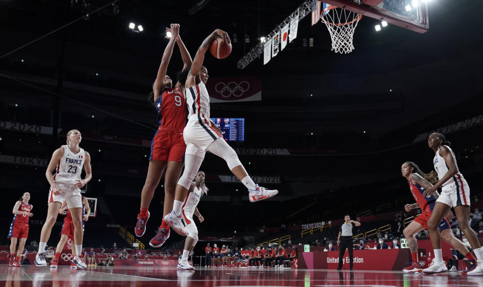 United States' A'Ja Wilson (9) and France's Endene Miyem (5) jump for a rebound during women's basketball preliminary round game at the 2020 Summer Olympics, Monday, Aug. 2, 2021, in Saitama, Japan. (AP Photo/Eric Gay)