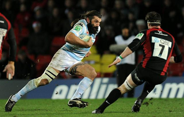 Racing's No. 8 Sebastien Chabal (L) runs with the ball in front of Saracen's Andy Saull (R) during the Heineken Cup rugby union match between Saracens and Racing Metro 92 at Vicarage Road in Watford on December 11, 2010. Racing Metro 92 won the game 24-21. AFP PHOTO / Adrian Dennis (Photo credit should read ADRIAN DENNIS/AFP/Getty Images)