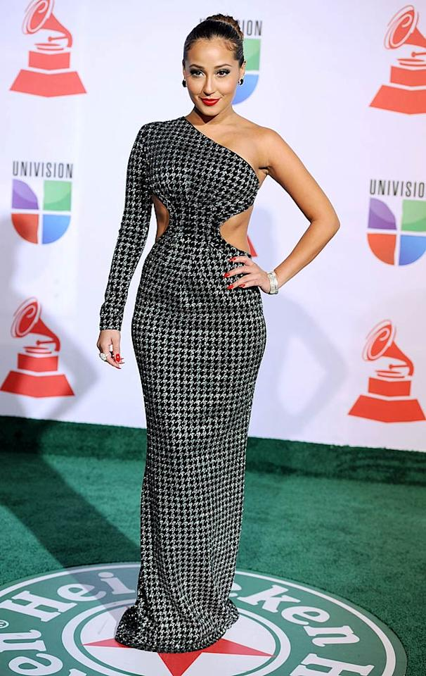 Singer/actress Adrienne Bailon showed off her toned waist in a one-shoulder LaQuan Smith dress complete with sexy cut-outs. (11/10/2011)