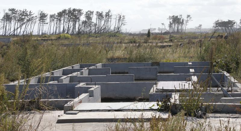 In this Oct. 9, 2012 photo, the foundation of a house is seen in a deserted land near the Arahama beach, severely damaged by the March 11, 2011 earthquake and tsunami, in Sendai, northeastern Japan. Japan's accounting of its budget for reconstruction from the disasters is crammed with spending on unrelated projects, while all along Japan's northeastern coast, dozens of communities remain uncertain of whether, when and how they will rebuild. (AP Photo/Koji Sasahara)