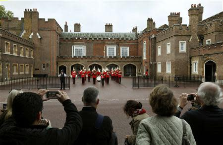 Royal fans wait outside St James's Palace before the christening of Prince George in London October 23, 2013. REUTERS/Suzanne Plunkett