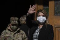 Bolivia's interim President Jeanine Anez, wearing a face mask to help curb the spread of the new coronavirus, waves during a procession Corpus Christi, in La Paz, Bolivia, Thursday, June 11, 2020. Anez has announced on Thursday, July 9, 2020, that she has tested positive for COVID-19. (AP Photo/Juan Karita)