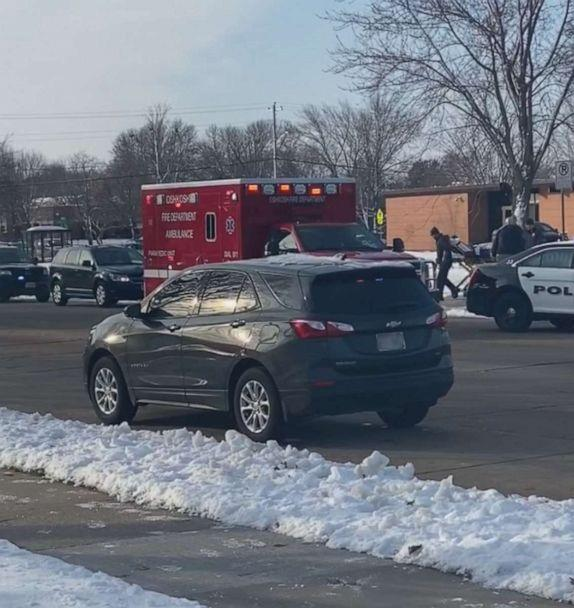 PHOTO: A person is carried out of Oshkosh West High School in Wisconsin on a stretcher after an officer-involved shooting, Dec. 3, 2019. (Obtained by ABC News)