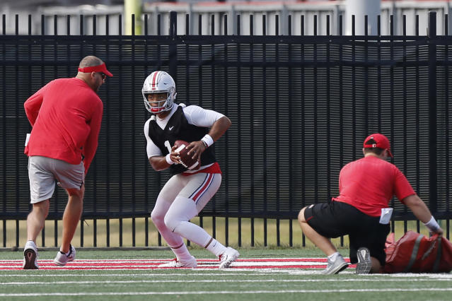 FILE - In this Aug. 2, 2019, file photo, Ohio State quarterback Justin Fields runs a drill during NCAA college football practice in Columbus, Ohio. Georgia transfer Justin Fields' performance will be key to the Buckeyes hopes of returning to the College Football Playoff for the first time since the 2016-17 season.(AP Photo/Jay LaPrete, File)