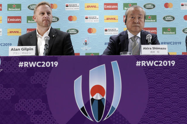 Alan Gilpin, left, tournament director for the 2019 Rugby World Cup and Japan Rugby 2019 CEO Akira Shimazu, right, attend during a press briefing on update relating to the anticipated impact of Typhoon Hagibis on the final round Rugby World Cup 2019 pool matches this weekend Thursday, Oct. 10, 2019, in Tokyo. (AP Photo/Eugene Hoshiko)