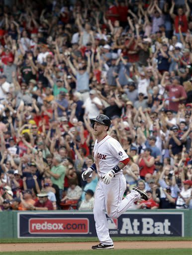 Boston Red Sox's Mike Carp rounds the bases after hitting a solo home run during the sixth inning of a baseball game against the Los Angeles Angels, Sunday, June 9, 2013, at Fenway Park in Boston. (AP Photo/Mary Schwalm)