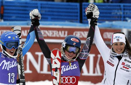 Mikaela Shiffrin (C) of the U.S. celebrates her victory with second-placed Maria Pietilae-Holmner (L) of Sweden and third-placed Nastasia Noens of France after the World Cup Alpine skiing women's slalom race in Bormio, January 5, 2014. REUTERS/Stefano Rellandini