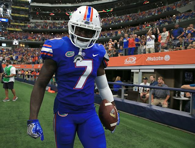 """Florida's <a class=""""link rapid-noclick-resp"""" href=""""/ncaaf/players/238449/"""" data-ylk=""""slk:Duke Dawson"""">Duke Dawson</a> is better off using his hands to intercept passes than hitting opponents helmets. (Getty Images)"""