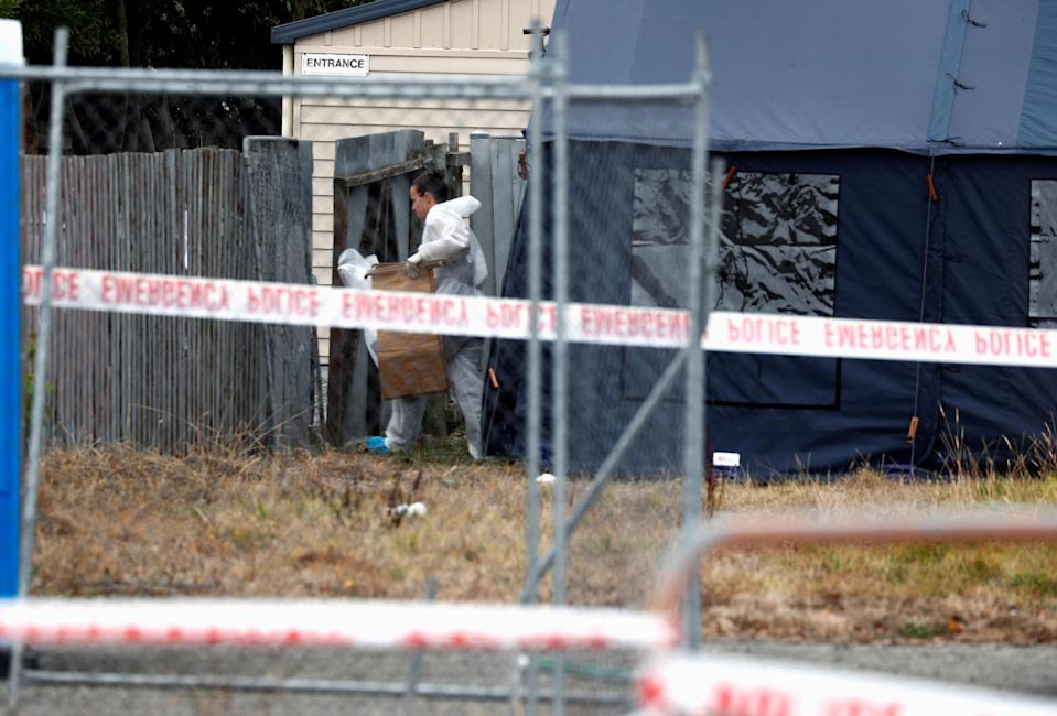 An investigator works at the site of Friday's shooting, outside the Linwood Mosque, in Christchurch. Source: Reuters