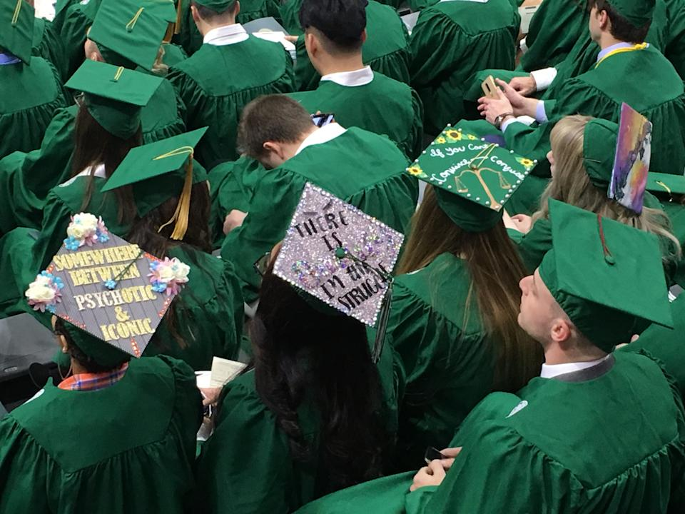 The Class of 2018 racked up an average of $29,200 in college loans to obtain bachelor's degrees — a record in the United States, according to the latest report by the Institute for College Access & Success.  The average in Michigan was even higher at $32,158, where 59% of graduates carry some college debt along with that diploma.  File photo taken at Michigan State University's Fall 2019 Commencement at the Breslin Center on Dec. 14.