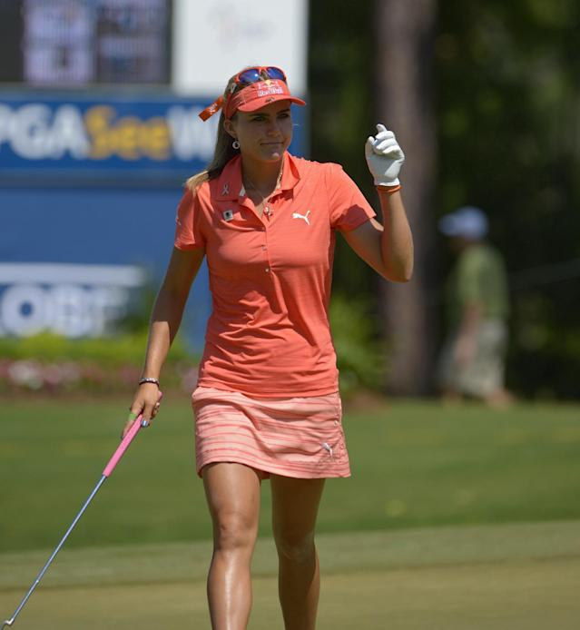 Lexi Thompson acknowledges the crowd after putting on the 18th hole during the second round of the Airbus LPGA Classic golf tournament at Magnolia Grove on Friday, May 23, 2014, in Mobile, Ala. (AP Photo/G.M. Andrews)