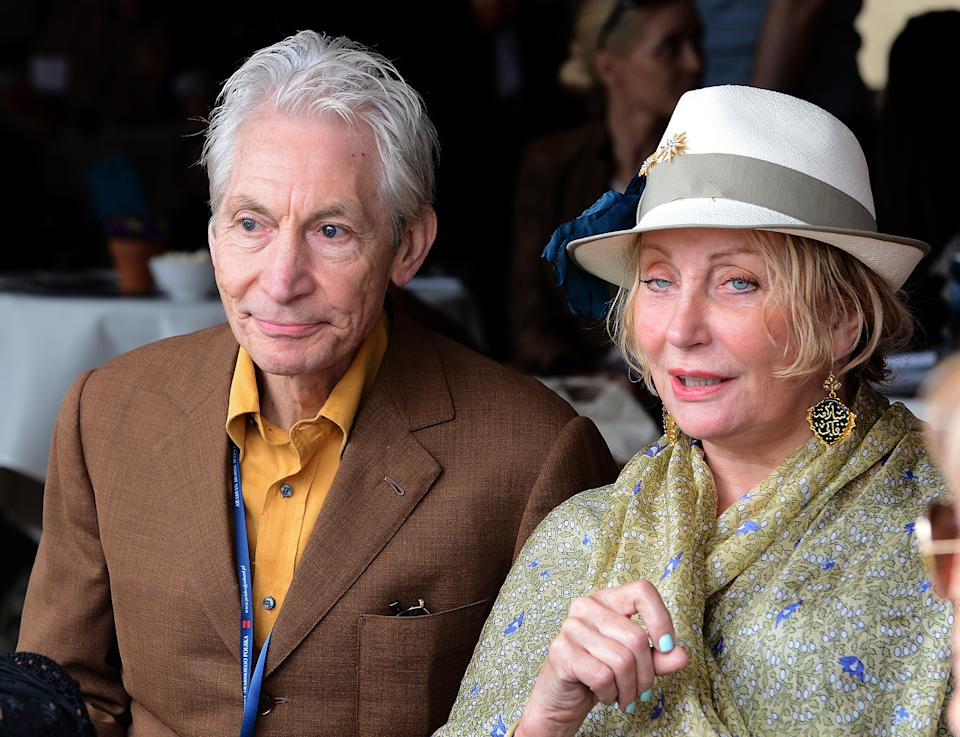 Charlie Watts, drummer of The Rolling Stones and his wife  Shirley watch presentation of horses during  Pride of Poland Arabian Horse sale in Janow Podlaski on August 12,2012. Shirley Watts bought mare Etnologia for 370 thousand Euros. AFP PHOTO/JANEK SKARZYNSKI        (Photo credit should read JANEK SKARZYNSKI/AFP/GettyImages)