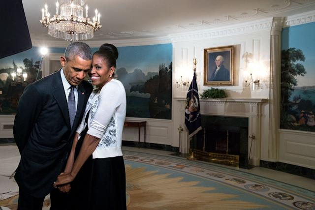 The first ladysnuggles against the president during a video taping for the 2015 World Expo in the Diplomatic Reception Room of the White House.