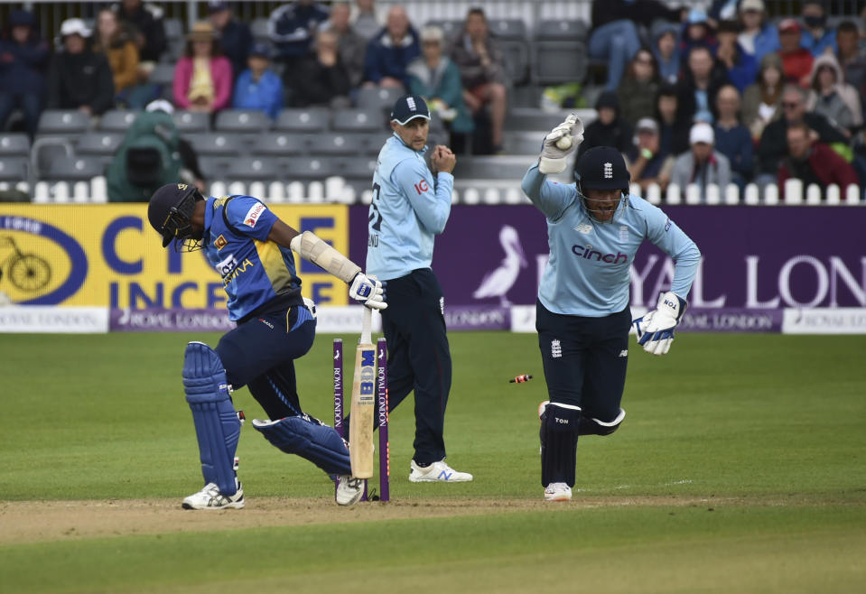 England's wicketkeeper Jonny Bairstow, right, celebrates the dismissal of Sri Lanka's Dushmantha Chameera, left, during the third one day international cricket match between England and Sri Lanka, at Bristol County Ground in Bristol, England, Sunday, July 4, 2021. (AP Photo/Rui Vieira)