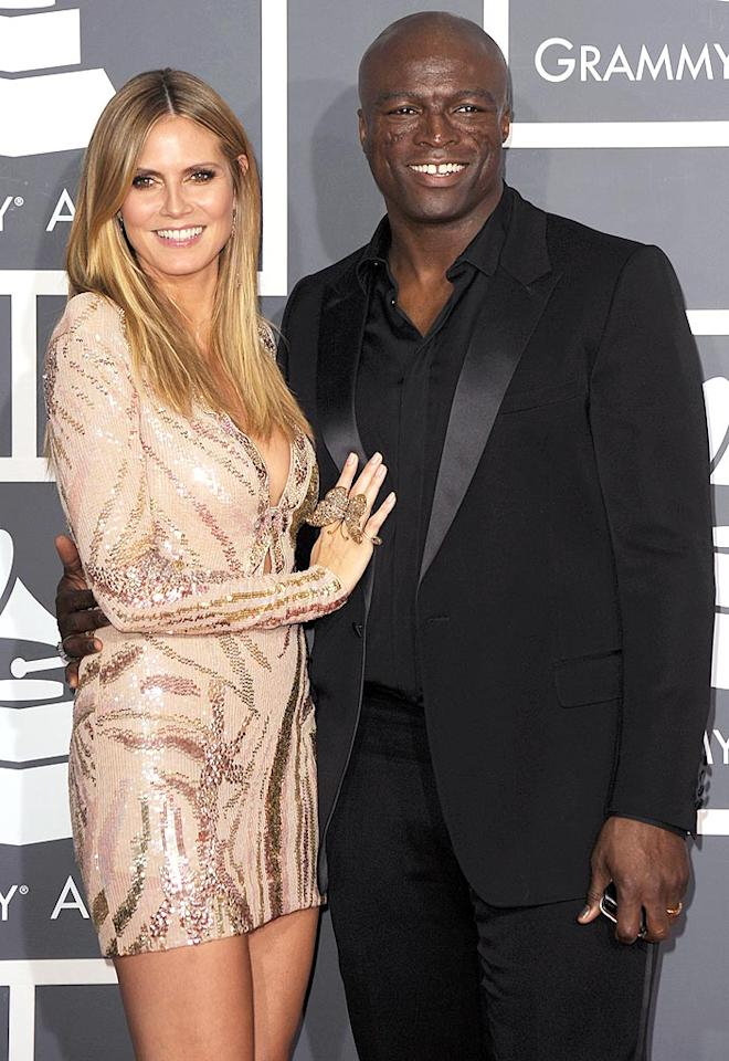 "Another woman who always supports her man on the red carpet: Supermodel/""Project Runway"" host Heidi Klum, posing here with hubby Seal at the Grammy Awards. Steve Granitz/<a href=""http://www.wireimage.com"" target=""new"">WireImage.com</a> - January 31, 2010"