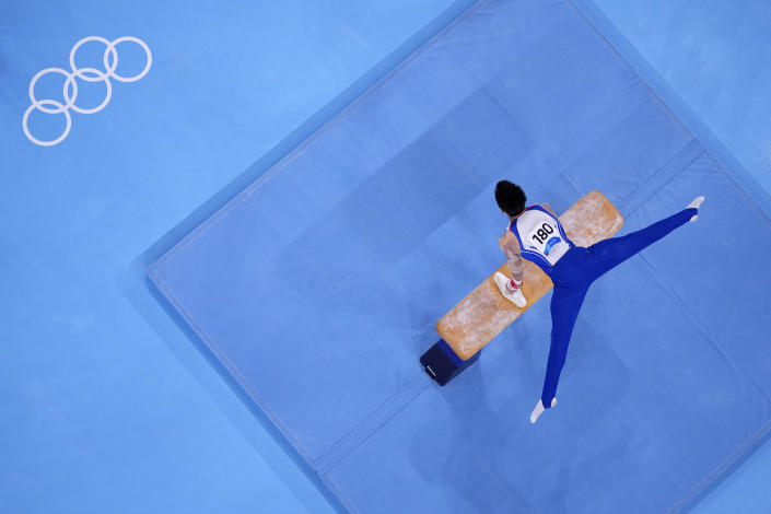 FILE - In this Aug. 1, 2021, file photo, Lee Chih-kai, of Taiwan, competes in the pommel horse artistic gymnastics men's final at the 2020 Summer Olympics in Tokyo, Japan. At the Games, men swing around a leather-covered block with handles called a pommel horse, that in early iterations roughly mimicked the size and shape of the actual animal. (AP Photo/Jeff Roberson, File)
