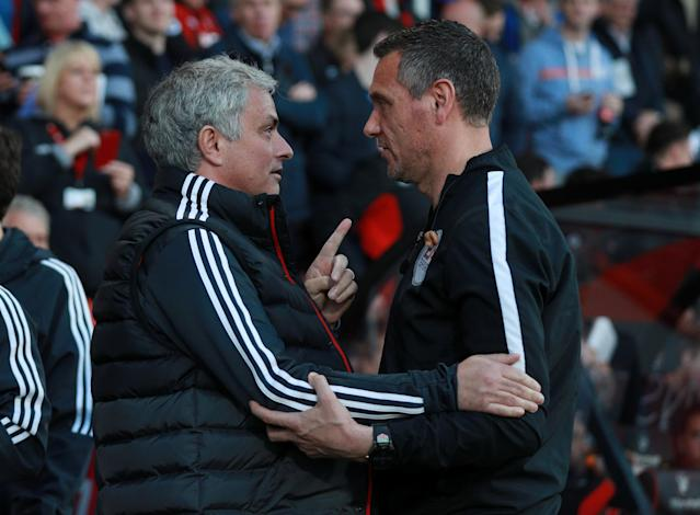 """Soccer Football - Premier League - AFC Bournemouth vs Manchester United - Vitality Stadium, Bournemouth, Britain - April 18, 2018 Manchester United manager Jose Mourinho speaks with fourth official Andre Marriner before the match REUTERS/Ian Walton EDITORIAL USE ONLY. No use with unauthorized audio, video, data, fixture lists, club/league logos or """"live"""" services. Online in-match use limited to 75 images, no video emulation. No use in betting, games or single club/league/player publications. Please contact your account representative for further details."""
