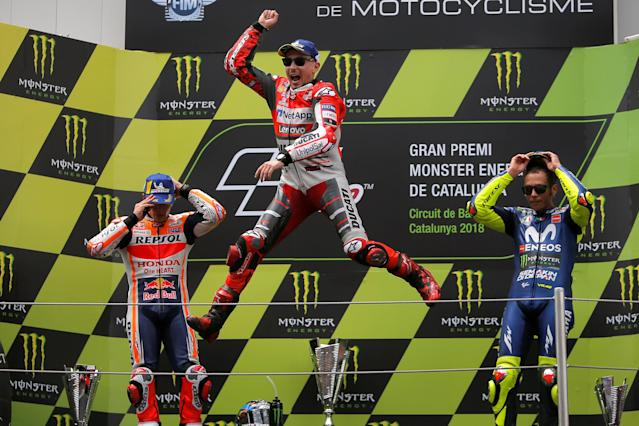 MotoGP - Grand Prix of Catalunya - Circuit de Barcelona-Catalunya, Barcelona, Spain - June 17, 2018 Ducati Team's Jorge Lorenzo celebrates after winning the race with second placed Repsol Honda Team's Marc Marquez and third placed Movistar Yamaha MotoGP's Valentino Rossi REUTERS/Jon Nazca TPX IMAGES OF THE DAY