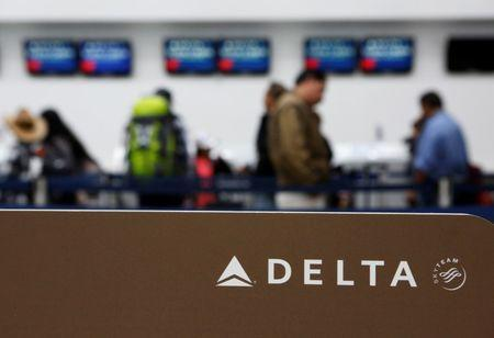 FILE PHOTO: Passengers check in at a counter of Delta Air Lines in Mexico City