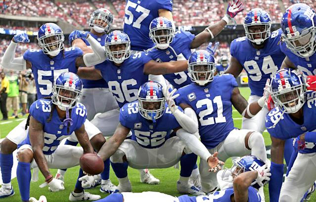 <p>New York Giants linebacker Alec Ogletree (52) is surrounded by teammates after intercepting a pass in the end zone against the Houston Texans during the second half of an NFL football game Sunday, Sept. 23, 2018, in Houston. (AP Photo/Michael Wyke) </p>