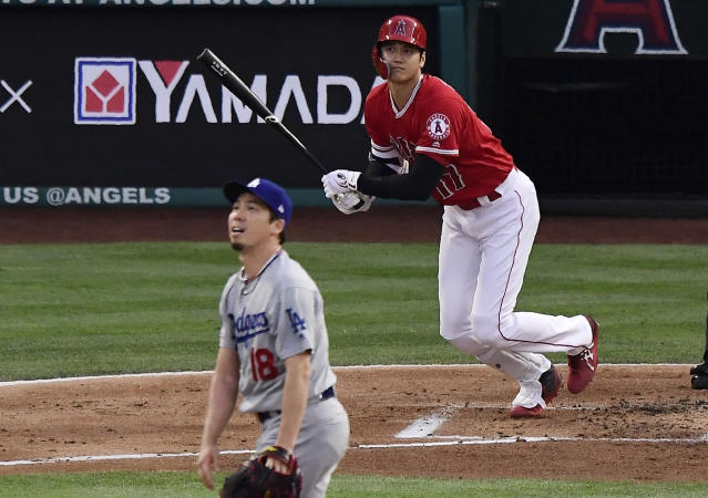 Los Angeles Angels' Shohei Ohtani watches his home run off Los Angeles Dodgers starting pitcher Kenta Maeda, foreground, during the first inning of a baseball game Tuesday, June 11, 2019, in Anaheim, Calif. (AP Photo/Mark J. Terrill)