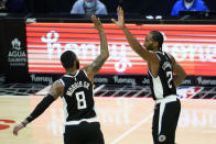 Los Angeles Clippers forwards Marcus Morris Sr. (8) and Kawhi Leonard (2) celebrate a point during the third quarter of an NBA basketball game against the Indiana Pacers, Sunday, Jan. 17, 2021, in Los Angeles. (AP Photo/Ashley Landis)