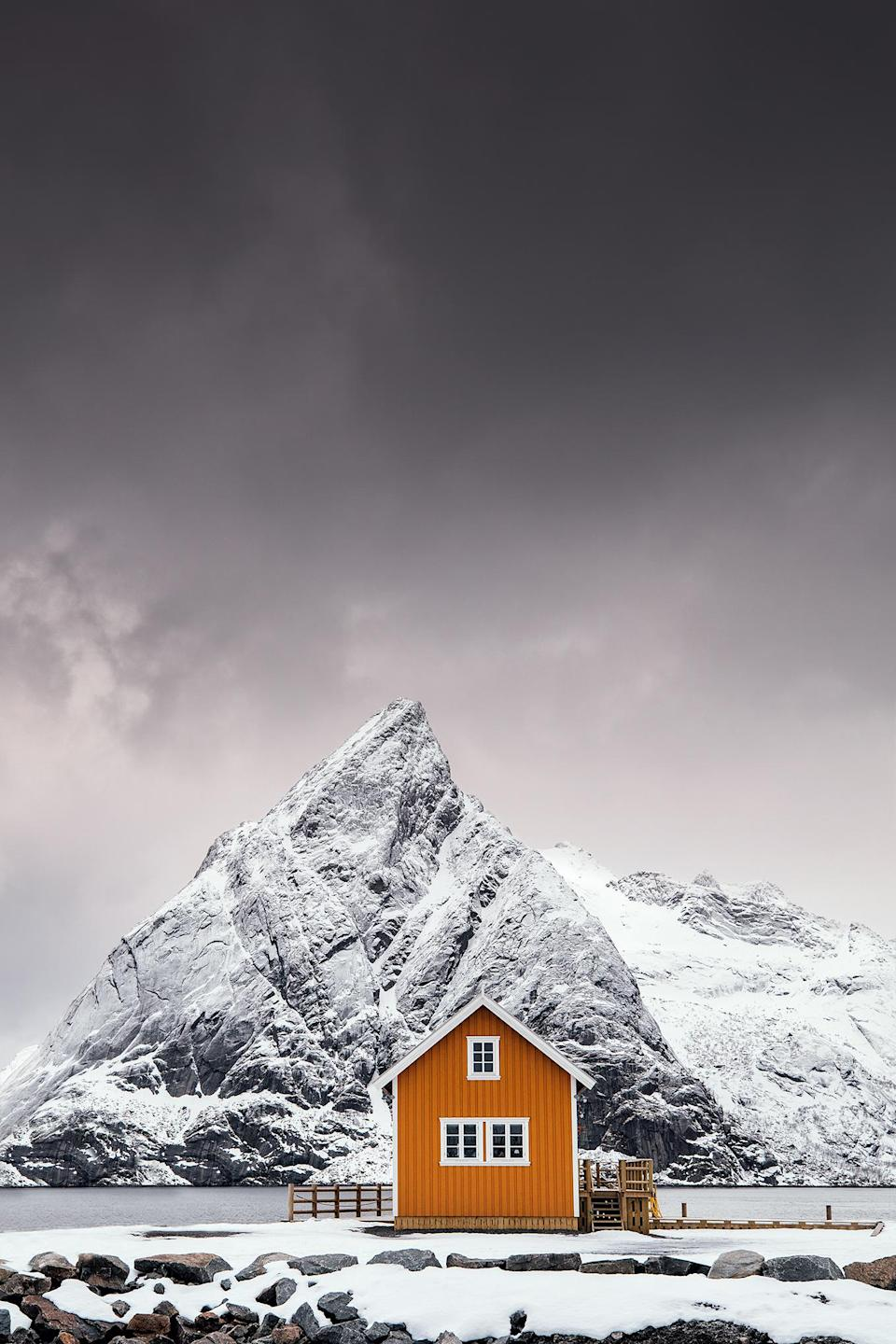 <p>This composition is quite popular amongst photographers at the moment and it's easy to understand why! The beautiful Mount Olstinden has almost the same shape as the roof of this cute yellow cabin and the yellow color creates some amazing contrast to the snow covered mountain. This place can be found in the Lofoten Archipelago at the small island named Sakrisøy. I've removed a small cabin in the left side during post process. Beside that, color correction, contrast and sharpness has been done in Lightroom and Photoshop. (Mikkel Beiter, Denmark, Winner, Open Travel and Denmark National Award, 2018 Sony World Photography Awards) </p>