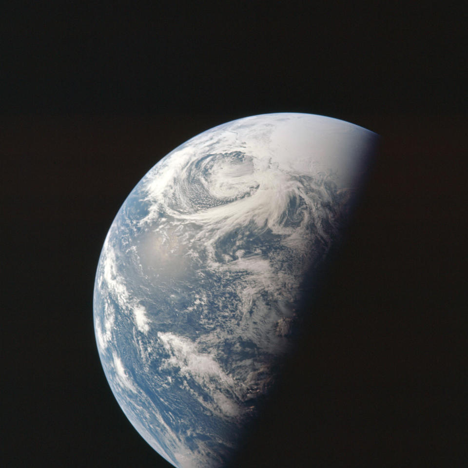 This April 1970 photo made available by NASA shows the Earth as the Apollo 13 mission heads towards the moon. (NASA via AP)