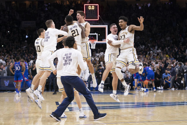 The Villanova Wildcats celebrate after defeating the Kansas Jayhawks at the Wells Fargo Center on Dec. 21, 2019 in Philadelphia. (Mitchell Leff/Getty Images)