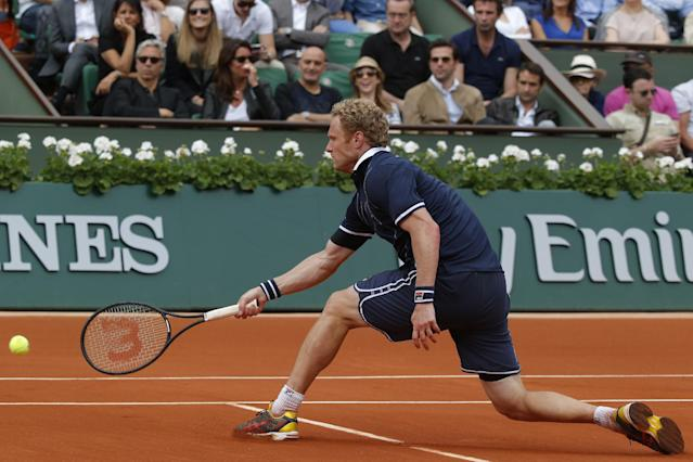 Russia's Dmitry Tursunov returns the ball during the third round match of the French Open tennis tournament against Switzerland's Roger Federer at the Roland Garros stadium, in Paris, France, Friday, May 30, 2014. (AP Photo/Michel Euler)