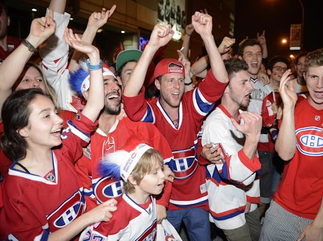 Montreal Canadiens fans in Montreal celebrate after the Canadiens advanced to the NHL hockey Stanley Cup Eastern Conference finals with a 3-1 win over the Boston Bruins in a game in Boston, Wednesday May 14, 2014. (AP Photo/The Canadian Press, Ryan Remiorz)