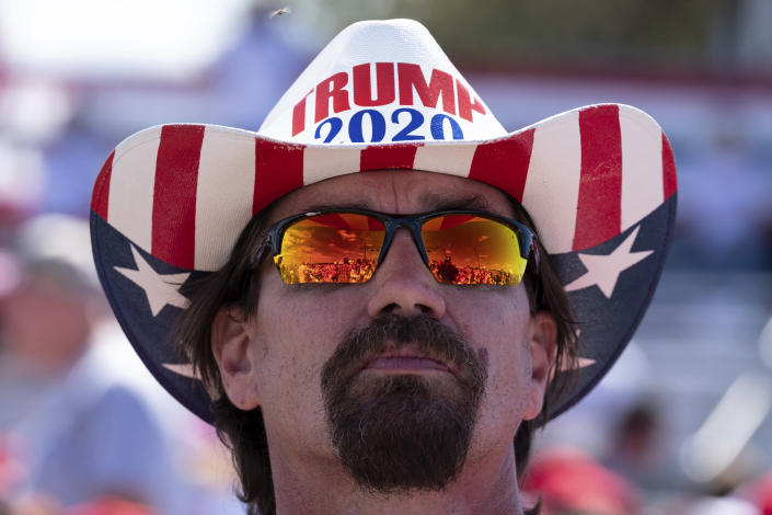 Frank Garner waits for the start of former President Donald Trump's Save America rally in Perry, Ga., on Saturday, Sept. 25, 2021. (AP Photo/Ben Gray)
