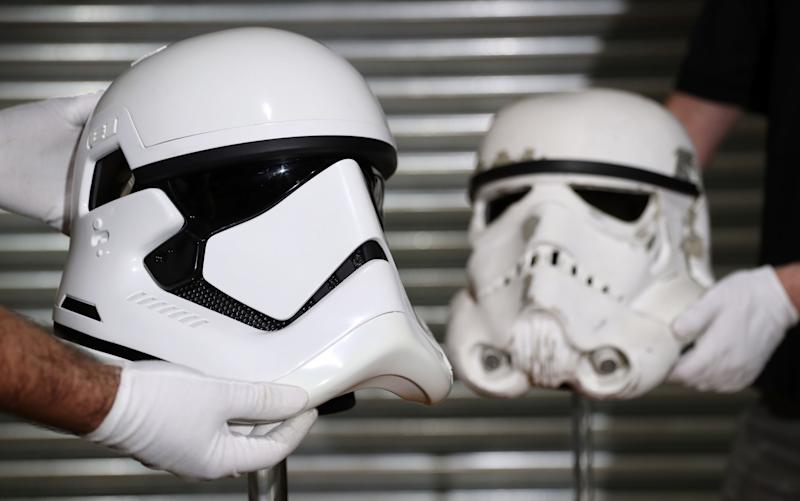 Stormtrooper helmets from Star Wars: The Last Jedi (left) and Star Wars: A New Hope (right) (Andrew Matthews/PA)